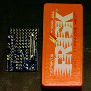 Left: MewPro w/ SMD parts and Herobus connector (soldered); Right: Frisk case sold in Japan